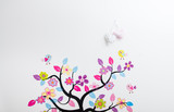 Handmade posters stuck tree with birds on the wall in children's room. - 126938014