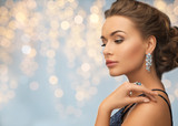 woman in evening dress with diamond earring - 126940605