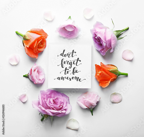 "Poster Inscription ""DON'T FORGET TO BE AWESOME"" written on paper with flowers on white"