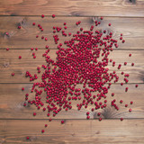 Cranberries on brown background.