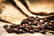 Roasted coffee beans on old wood background