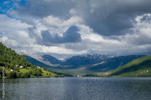 Poster Norway fjord and mountains landscape with dramatic clouds