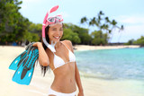 Snorkel girl on beach vacation holding flippers - 126985833