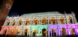 old building with architectural arches illuminated with colorful