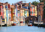 colored houses and a bridge on Canal in Burano island in Italy