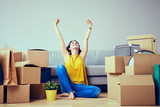 Happy young woman moving to new home - having fun - 126997695