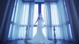 Back side of bride in wedding dress come to window and uncover white curtains. Cold shades. Celebration day