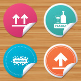 Round stickers or website banners. Fragile icons. Delicate package delivery signs. This side up arrows symbol. Circle badges with bended corner. Vector