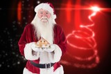 Portrait of santa clause holding toy house