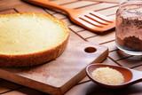 Freshly baked cheesecake on wooden board. Homemade dessert