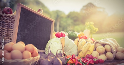 Vegetables and fruit with slate