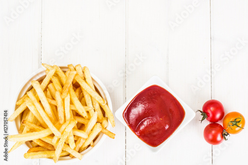 Poster French Fries Potato with Ketchup on Wooden Background