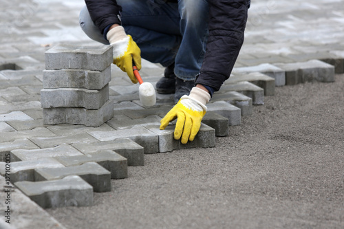 Paving stone worker Poster