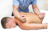 Young man on wellness treatments sports massage