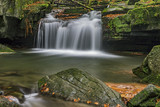 Autumn waterfalls with stones