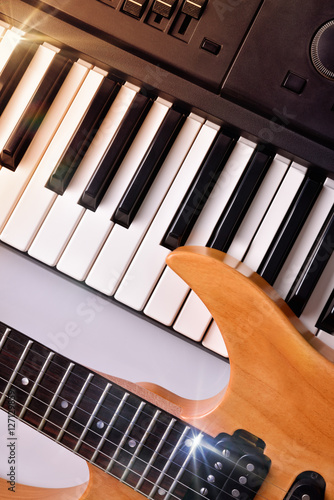 Poster Electric guitar and synthesizer top view vertical composition