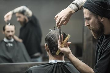 Doing haircut in barbershop