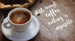 Coffee Quote over cup of coffee on wooden surface
