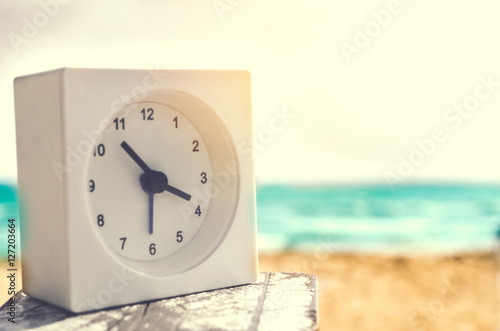 modern alarm clock on beach Poster
