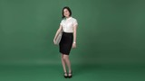 Young beautiful business lady with the suitcase, chroma key green screen background