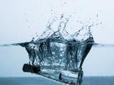 Bottle splashing in water
