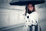 Beautiful fashion woman with umbrella walking outdoor