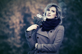 Happy young fashion woman with a flowers walking outdoor
