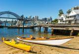 Kayaks beach levender Bay Sydney, harnour bridge city in background.