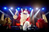 DJ Santa Claus mixing up some Christmas event.  Disco light arou