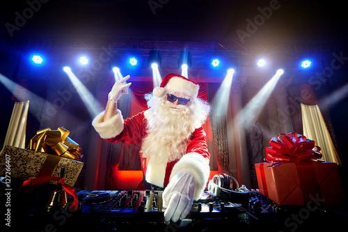 Poster DJ Santa Claus mixing up some Christmas event.  Disco light arou