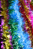 The multi-colored tinsel. Background. Portrait orientation
