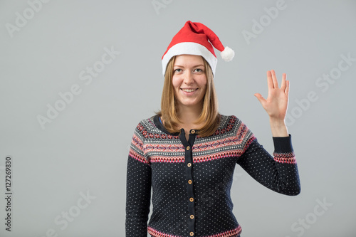 Woman wearing Santa hat showing Vulcan salute Poster