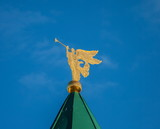 Weather vane in the form of a golden angel figure