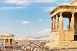 Ancient Greek Acropolis. The famous Porch of the Caryatids with six statues supporting the architrave, the southern part of the temple of the Erechtheion and fragment of the Propylaea