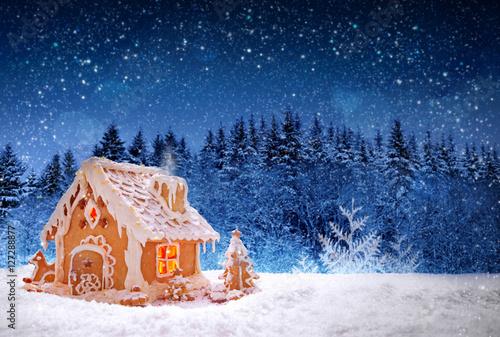 Poster Christmas Gingerbread house and snowfall.