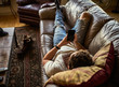 bearded guy relaxing on couch at home using smart phone