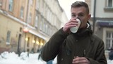 Teenager city walking with cup of coffee in winter time