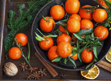 Clementines winter fruits with spices and decorative fir tree br