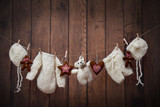 Warm baby clothes and teddy on a clothesline with Christmas decorations - 127339830