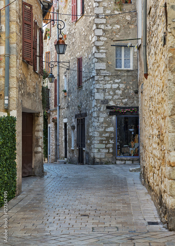 Narrow cobbled street in old village Vence , France. © arbalest