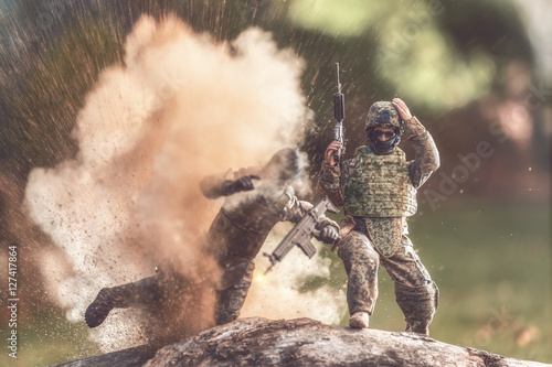 Poster Soldier avoiding an explosion