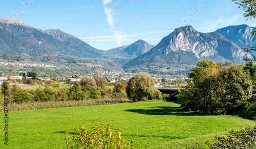 Mountain range in Italy.Trentino,Italy,October 29, 2016, Panorama of the mountains of Trento in autumn,still visible the morning mist.
