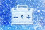 Empty car battery,  battery is discharged during winter freezing, winter car battery problem, car battery symbol with snow - 127425023