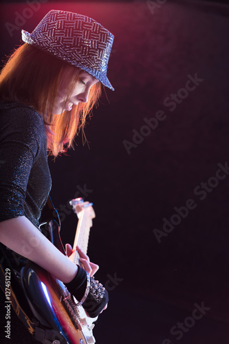 showgirl intensely playing her guitar live Poster