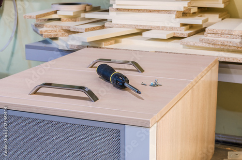 Plakat The assembly of kitchen furniture