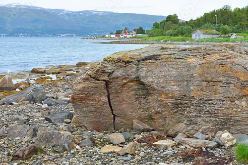 Poster Rocks on shore. Northern landscape