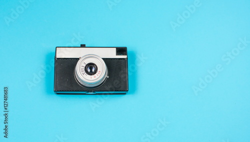 vintage film camera on blue background
