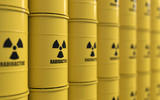 3D rendering of yellows barrels containing radioactive material  - 127490650
