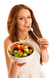 healthy eating  - woman eats a bowl of greek salad isolated over