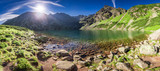 Fototapety Panorama of sunrise at Czarny Staw Gasienicowy in Polish Mountains